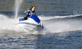 stock photo of jet-ski  - action photo of young woman on seadoo at high speed - JPG