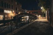 Empty Street Along Water Channel In Venice By Rainy Night poster