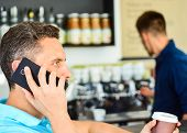 Man Holds Cup Of Drink While Have Mobile Conversation. Coffee To Go Useful Option For Busy People. C poster