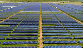 Down The Center Row Aerial Drone View Above Huge Solar Panel Farm , Thousnads Of Solar Panels In Hug poster