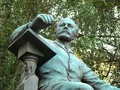 stock photo of tchaikovsky  - Monument to composer Peter Tchaikovsky before a conservatory building - JPG