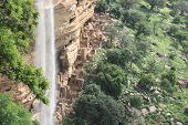 foto of dogon  - Old Dogon buildings and waterfall in Dogonland - JPG