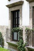 foto of hacienda  - Colonial balcony from a vintage mexican building hacienda style - JPG