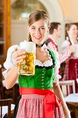 stock photo of stein  - Young people in traditional Bavarian Tracht in restaurant or pub - JPG