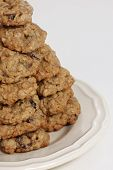 stock photo of baked raisin cookies  - A mountain of cookies piled on a plate - JPG