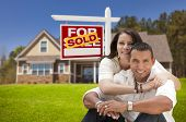 picture of yard sale  - Young Happy Hispanic Young Couple in Front of Their New Home and Sold For Sale Real Estate Sign - JPG