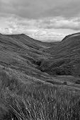 foto of long winding road  - black and white long grass and winding road with mountains in county Donegal Ireland - JPG