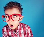 pic of attitude boy  - Surprised five years old boy wearing glasses - JPG