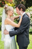 picture of full cheeks  - Happy wife touching her new husbands cheek in the countryside - JPG