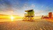 pic of florida-orange  - Miami South Beach sunrise with lifeguard tower and coastline with colorful cloud and blue sky - JPG