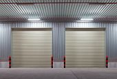 stock photo of roller door  - Shutter door or rolling door outside factory night scene - JPG
