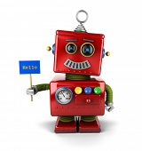 stock photo of robot  - Little happy vintage toy robot holding a hello sign over white background - JPG
