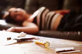 pic of meth  - Woman Slumped On Sofa With Drug Paraphernalia In Foreground - JPG