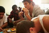 picture of crack addiction  - Gang Of Young Men Taking Drugs Indoors - JPG