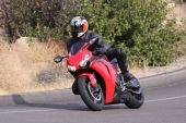 foto of crotch-rocket  - Red Motorcycle Sport Bike speeding through a corner in the Mountains - JPG