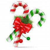stock photo of holiday symbols  - Candy canes with christmas decoration - JPG