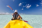 pic of canoe boat man  - Caucasian man is kayaking in sea at Maldives - JPG