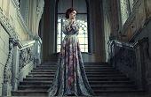 image of temperance  - beautiful woman in elegant dress posing on stairs in old vintage interior  - JPG