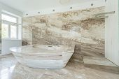 image of enormous  - Photo of enormous marble bath in spacious bathroom - JPG