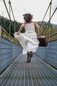 image of cinderella  - Bride Walking On The Bridge With Her Suitcase - JPG