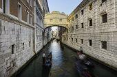 stock photo of gondola  - Gondolas passing under Bridge of Sighs - JPG