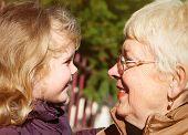 foto of granddaughters  - happy grandmather and granddaughter in park - JPG
