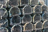 foto of lobster boat  - Lobster pots stacked on the quay in Padstow Cornwall England UK - JPG