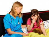 image of cough  - Doctor examining her little patient with severe coughing - JPG