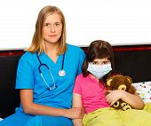 stock photo of influenza  - Sick girl with influenza at the hospital with health care professionalist - JPG