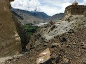 image of mustang  - A small Buddhistic stupa on a rocky hill near the oasis city Kagbeni in the Annapurna Himalayas of Mustang Nepal during monsoon - JPG