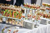 image of catering service  - catering services background with snacks on guests table in restaurant at event party - JPG