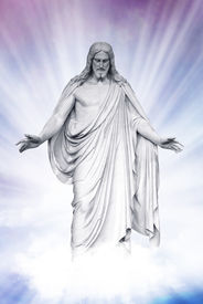 foto of atonement  - Statue of Jesus Christ on blue sky clouds background Christianity concept - JPG
