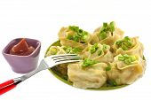 stock photo of tatar  - Tatar dishes dumplings on a plate with ketchup - JPG