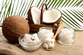 image of sackcloth  - Coconut with jars of coconut oil and  cosmetic cream on sackcloth on natural background - JPG