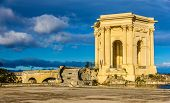 stock photo of aqueduct  - Water tower at the end of aqueduct in Montpellier France - JPG
