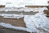 stock photo of sandbag  - White sandbags for flood defense closeup photo - JPG