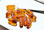 picture of gels  - Lecithin gel vitamin supplement capsules on whaie - JPG
