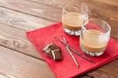 stock photo of vanilla  - Coffee liqueur with chocolate and vanilla on the wooden table - JPG