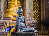 stock photo of hermit  - statue of hermit located in front of temple - JPG