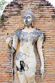 picture of gautama buddha  - Buddha Statue in Wat Mahathat Temple in Sukhothai Historical park at sunrise Thailand - JPG