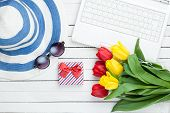picture of shoe-box  - White computer and flip flops shoes with clothes and gift box with tulips on white wooden background - JPG
