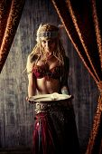 stock photo of fortune-teller  - Magnificent fortune teller holding crystal ball - JPG