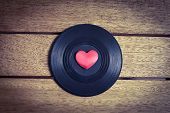 image of heart sounds  - A vinyl record with a red love heart