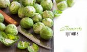 foto of brussels sprouts  - Brussels sprouts with leaves and knife on wood - JPG
