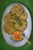 stock photo of plantain  - Delicious plantain patties served as an appetizer with chili sauce - JPG
