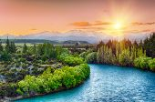 pic of bend over  - Beautiful sunset over the bend of the river Clutha with Southern Alps peaks on the horizon - JPG
