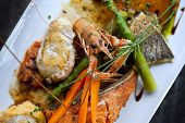 stock photo of crustacean  - Dish with crustacean fish vegetable and sauce - JPG