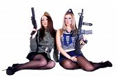 stock photo of cap gun  - Two women in the military uniform with guns isolated over white background - JPG