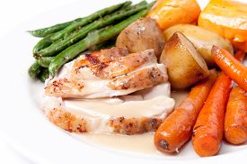 picture of potato-field  - roast turkey dinner with seasonal vegetables for a family holiday meal