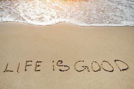stock photo of sea life  - life is good written on the sand beach  - JPG